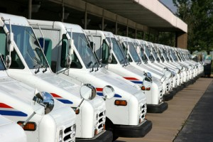 USPS mail trucks lined up with holiday packages